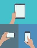 Satz Hände, die digitale Tablette und Handy halten Stockfoto