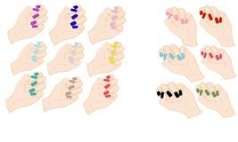 Satz Hände mit farbigen Nägeln Stockfotografie