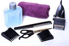 Satz Haarpflegeprodukte zum Haarscherer stockfoto