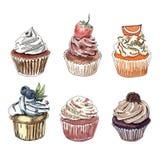 Satz Hand gezeichnete kleine Kuchen Stockbild