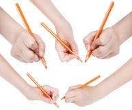 Satz Hände zeichnen durch den orange lokalisierten Bleistift Lizenzfreie Stockbilder