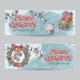 Satz horizontale Weihnachtsfahnen mit dem Bild eines Lamms, der Geschenke und der Weihnachtskränze Stockbild