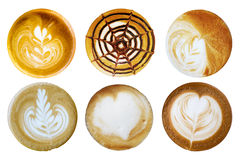Satz Kaffee Latte-Kunstschaum formte Draufsicht über weißen Hintergrund Stockbilder