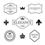 Satz kalligraphische Flourishgestaltungselemente - Fleur de Lis, Kronen, Rahmen und Grenzen - dekorative Weinleseart Lizenzfreie Stockbilder