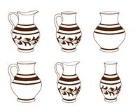 Satz keramische Tonware in den braunen und weißen Farben Stockfotos