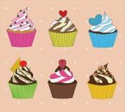 Satz kleine Kuchen auf Weinlesehintergrund Lizenzfreies Stockbild