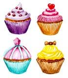 Satz kleine Kuchen mit Sahne Lizenzfreie Stockfotografie