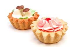 Satz Kuchen mit Buttercreme Stockbilder