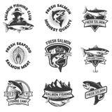 Satz Lachsfischenembleme Meeresfrüchte Gestaltungselemente für Logo Stockbilder