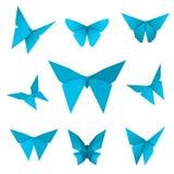Satz lokalisierte fliegende Papierschmetterlinge blauer Schmetterling auf dem weißen Hintergrund Japanische Origami-, Handwerks-  Lizenzfreies Stockfoto