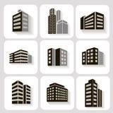 Satz Maßgebäudeikonen im Grau und Stockfotos