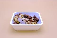 Satz Mandeln und Erdnüsse in einer Schüssel Lizenzfreies Stockbild