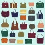 Satz mehrfarbige weibliche Taschen Lizenzfreie Stockbilder