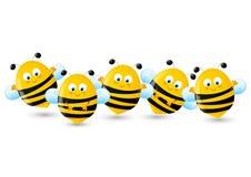 Satz nette Bienen auf Weiß Lizenzfreie Stockfotos