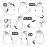 Satz nette Katzen mit Weihnachtshüten Lizenzfreie Stockfotografie