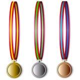 Satz olympische Medaillen Stockbilder