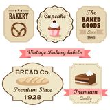 Satz Retro- Bäckereiaufkleber der Weinlese, Stempel und Gestaltungselemente, lokalisierte Illustrationen Stockfotos