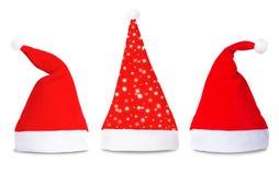 Satz rote Santa Claus-Hüte lokalisiert Lizenzfreie Stockbilder