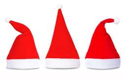 Satz rote Santa Claus-Hüte lokalisiert Lizenzfreie Stockfotos