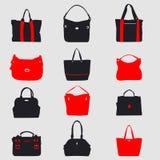 Satz rote und schwarze Handtaschen Lizenzfreies Stockfoto