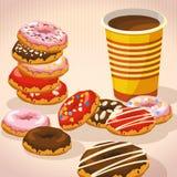Satz süße Schaumgummiringe, Tasse Kaffee Stockfotos