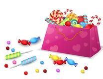 Satz Süßigkeiten in der Tasche lokalisiert auf weißem Hintergrund Lizenzfreies Stockfoto