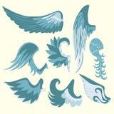 Satz schöne nette Karikatur-blaue und weiße Flügel Stockfoto