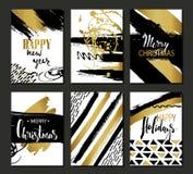 Satz Schablone der frohen Weihnachten und des guten Rutsch ins Neue Jahr der Karte Hand gezeichnete Beschaffenheiten, beschriften Lizenzfreie Stockfotografie