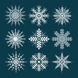 Satz Schneeflocken auf blauem Hintergrund Frohe Weihnachten, neues Jahr Stockfotografie