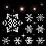 Satz Schneeflocken und blinkende Ausbrüche Sammlung Elemente für Weihnachten und neue Jahre entwerfen Lizenzfreie Stockfotografie
