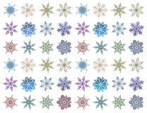 Satz Schneeflocken von verschiedenen Formen und von Farben Schöner Schnee lizenzfreie stockfotografie