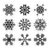 Satz schwarze Schneeflocken Stockfotos