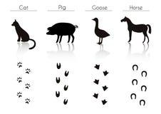 Satz schwarze Vieh-und Vogel-Schattenbilder: Katze, Schwein, Gans Stockfotografie