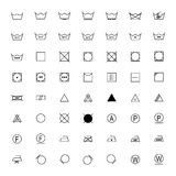 Satz schwarze Wäschereisymbole auf weißem Hintergrund, Illustration Stockbild