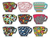 Satz Teeschalen mit kühlen Mustern. Lizenzfreies Stockfoto