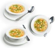 Satz Veggie-Suppe geschossen in den verschiedenen Winkeln, vegetarische Suppe lokalisiert auf Weiß, Beschneidungspfad eingeschlos Lizenzfreies Stockbild