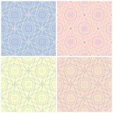 Satz verblaßte farbige nahtlose Hintergründe mit geometrischen Mustern Lizenzfreie Stockfotos