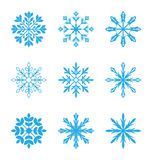 Satz verschiedene Schneeflocken lokalisiert auf weißem Hintergrund Stockbilder