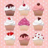 Satz verschiedene Valentinsgrußkleine kuchen, Muffins, Illustrationshintergrund Stockbilder