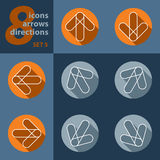 Satz von acht Ikonen mit Pfeilen in allen acht Richtungen Lizenzfreie Stockfotos
