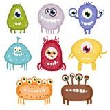 Satz von acht lustigen toothy Monstern. Lizenzfreie Stockfotos