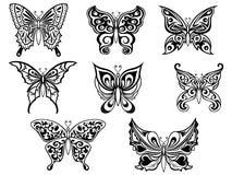 Satz von acht schwarzen Schmetterlingen Stockbild