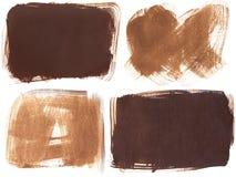 Satz von vier braunen Schmutzpinselstrichhintergründen Stockbild