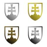 Satz von vier einfach lokalisierten metallischen slowakischen Emblemen Stockfotografie