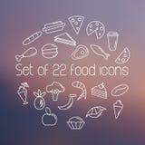 Satz von zweiundzwanzig Lebensmittelikonen auf unscharfem Hintergrund Entwurfsikonen eingestellt Linie Ikonenart Stockbilder