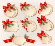 Satz Weihnachtsgutscheine mit rotem Geschenk beugt Esprit Lizenzfreie Stockbilder