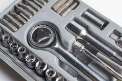 Satz Werkzeuge von Köpfen in einem Kasten Stockbilder