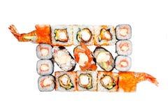 Satzrollen und Sushi, würzige Bass-Soße der Sushi, das würzige Aalsushi der Soße, Lachse Lizenzfreie Stockfotos