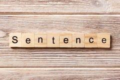 Satzwort geschrieben auf hölzernen Block Satztext auf Tabelle, Konzept Lizenzfreies Stockfoto