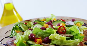 Sauce being poured in salad. Close-up of sauce being poured in salad stock video footage